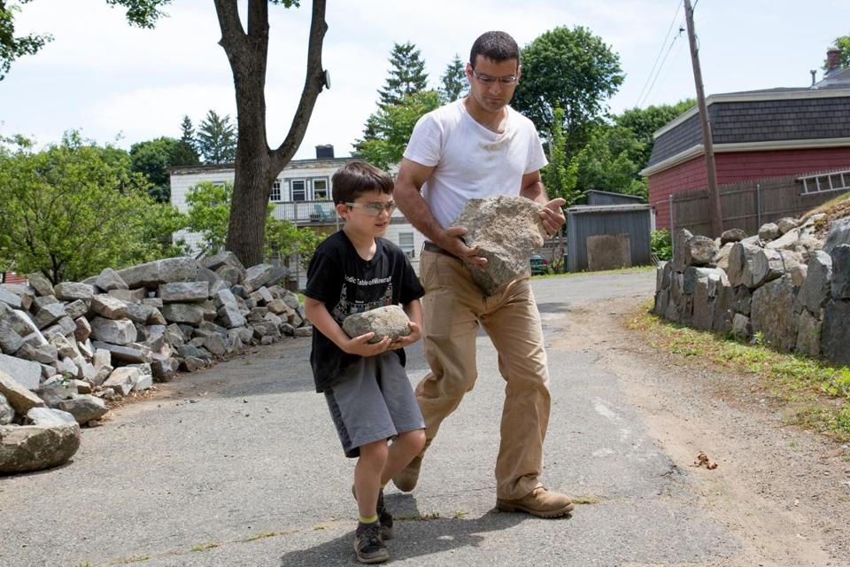 John Umina of Waltham and his son, Michael, built a stone wall.